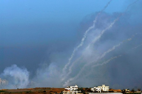 A barrage of four Palestinian Qassam rockets leave smoke trails in the sky as they are fired by Hamas militants on January 6, 2009 inside the Gaza Strip towards the Israeli town of Sderot as seen from Israel's border with the Palestinian territory. Israel is intensifying its wide-scale ground assault against the Gaza Strip in an effort to put an end to Hamas rocket attacks against the Jewish State.  (Photo by David Silverman/Getty Images)
